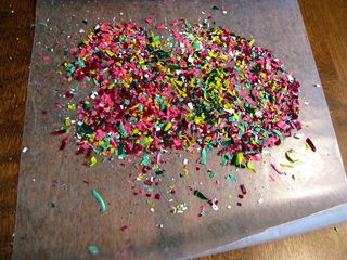 Crayon cross shavings on wax
