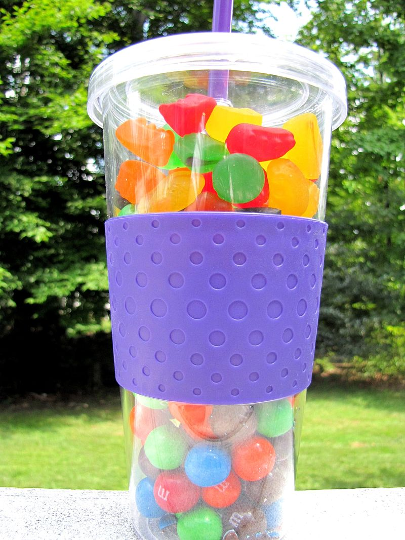 Customer service purple cup filled with candy gift