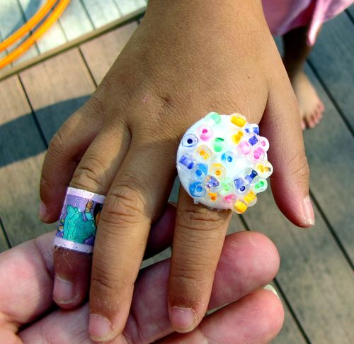 Milk tab rainbow beaded ring on Ls hand