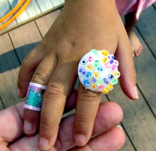 Milk tab rainbow beaded ring on Ls hand