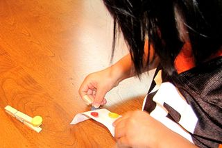 Clothespins gluing on buttons