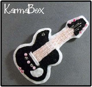 Karma box guitar hair clip