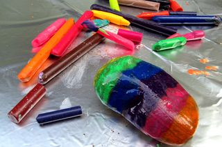 Rainbow rock colored stripes with crayons